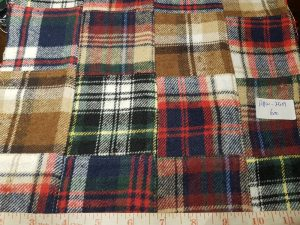 A patchwork fabric made by sewing together twill madras fabrics squares