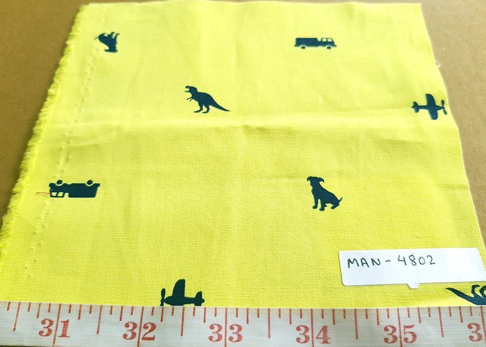 cotton print fabric with dogs dinosaurs trucks and planes