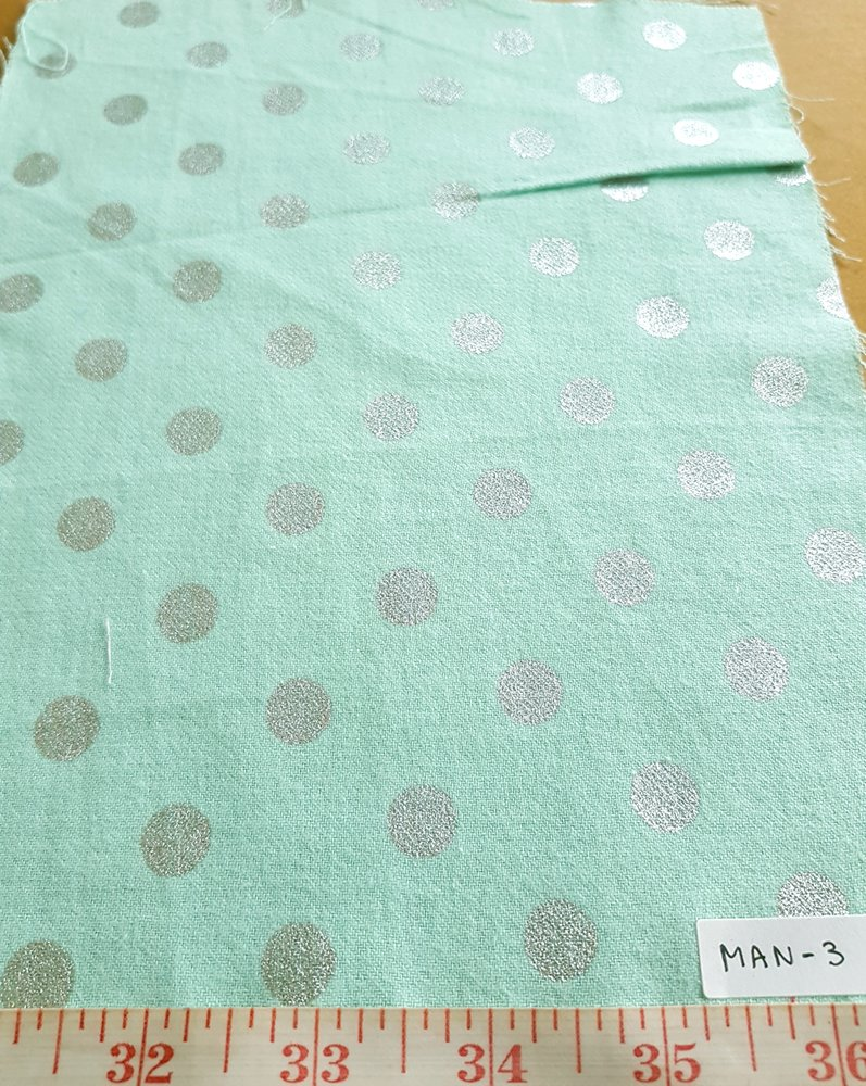 Polka dots fabric in mint color with silver dots, made of cotton