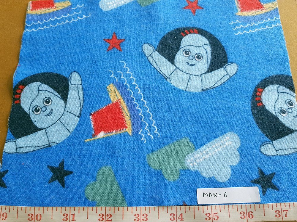Cotton print fabrics with cartoon animated prints of a girl and sail boats