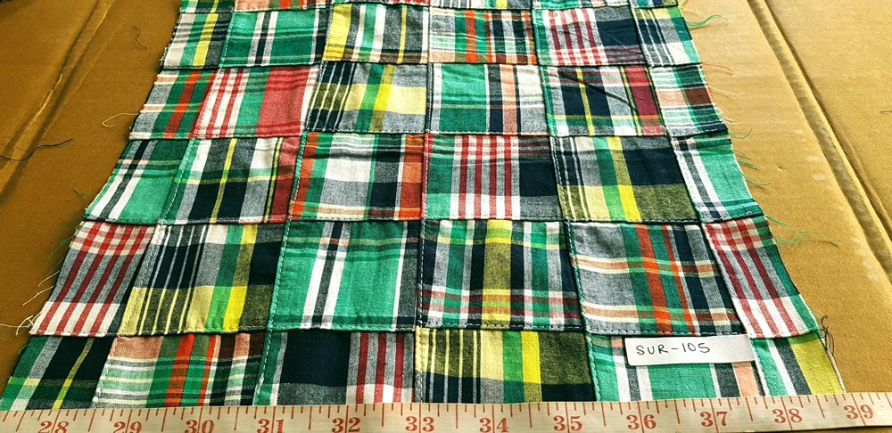 patchwork madras plaid fabric in preppy kelly green, black, yellow and red colors