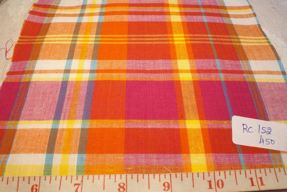 Madras fabric in Orange, fuschia, blue, yellow and white plaids