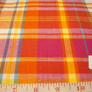 Madras fabric in Orange, fuschia, blue, yellow and white plaids