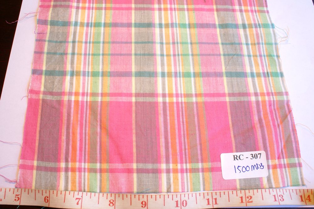 Madras check fabric in pink, gray, green, yellow and white plaids