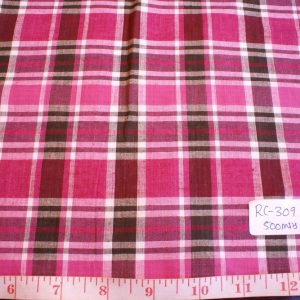 Madras fabric in pink, orange, brown and white plaid checks
