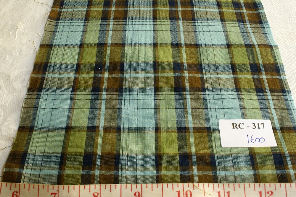 Madras plaid in colors of light indigo, brown and army green