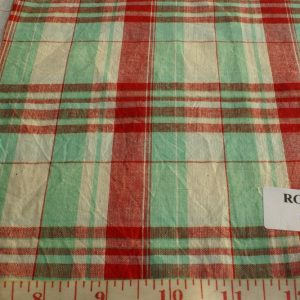 Plaid fabric in colors of mint green, red and muted white