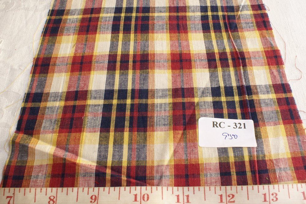 Plaid fabric in Rust red, yellow, blue and white plaids