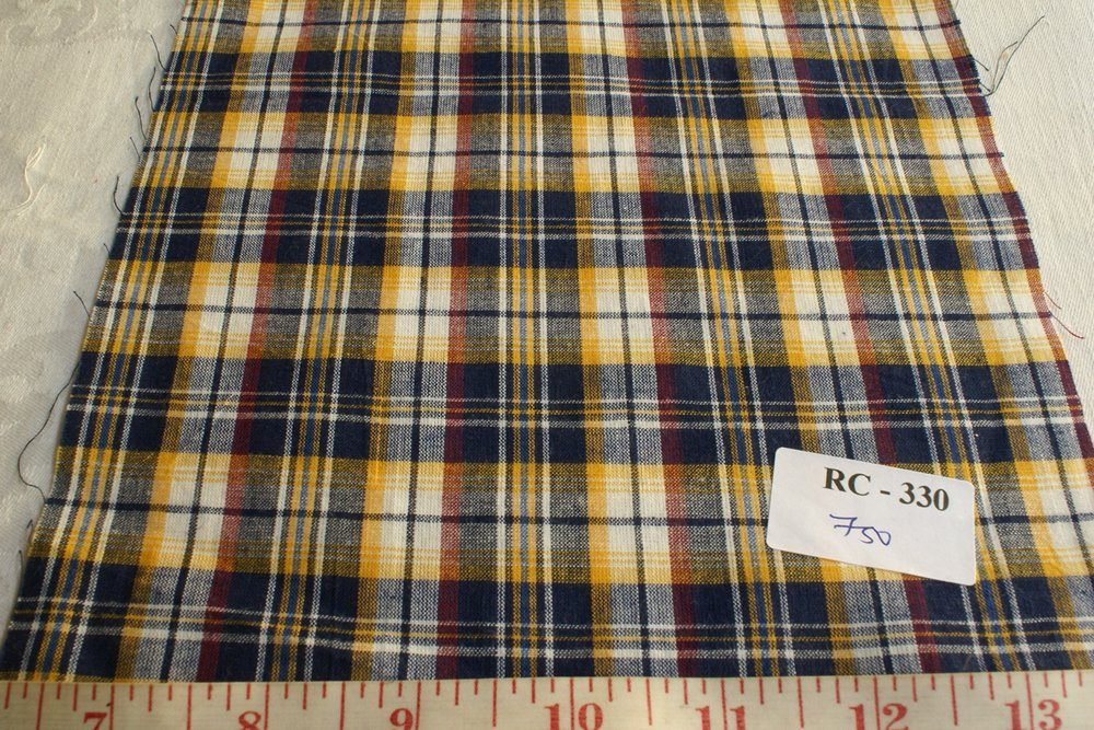 Plaid fabric in blue, yellow, rust red and white plaid madras