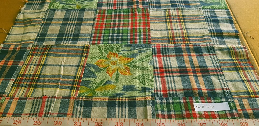 Patchwork madras fabric with a floral print theme