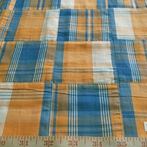 Patchwork Madras Fabric - plaid madras fabric patches sewn together into a preppy collage of plaids of various colors, ideal for men's and boys clothing