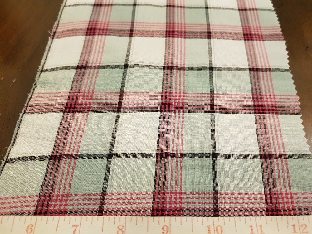 Bleeding Madras Fabric made with yarns dyed using vegetable dyes only, into a plaid madras pattern, for bleeding madras shirts.