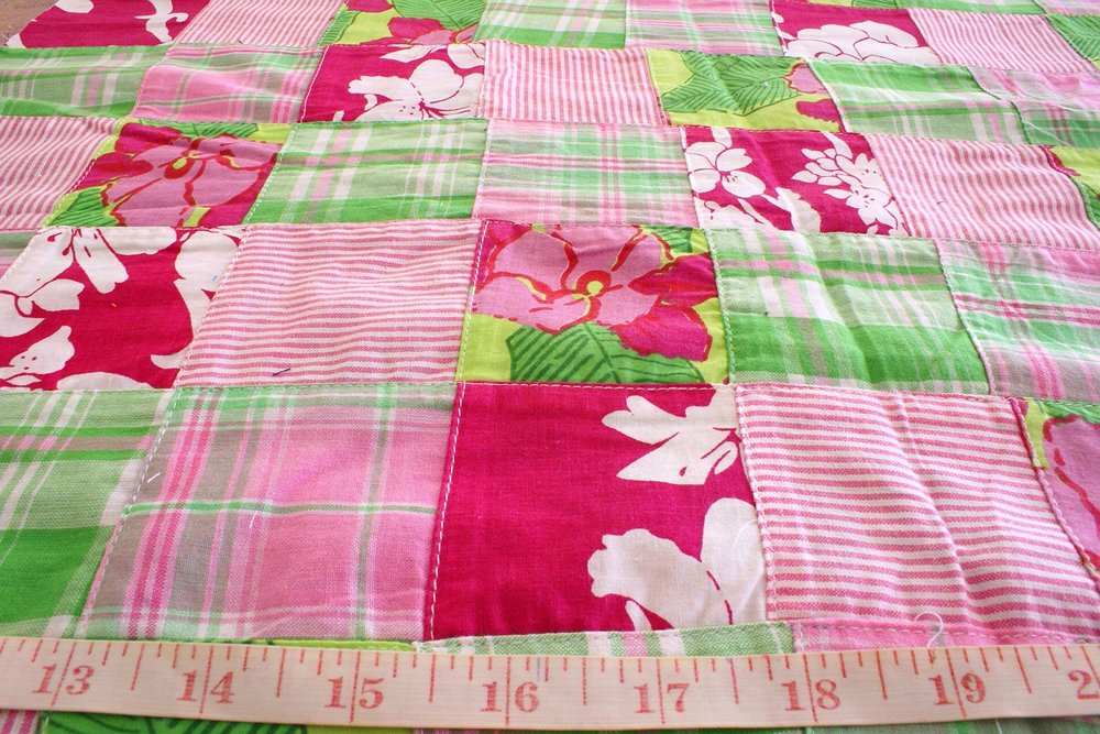 Patchwork printed fabric with patches of prints and plaids in cotton, ideal for children's wear, quilting and sewing projects, and crafts.